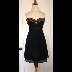 Black strapless dress with gold beaded bust